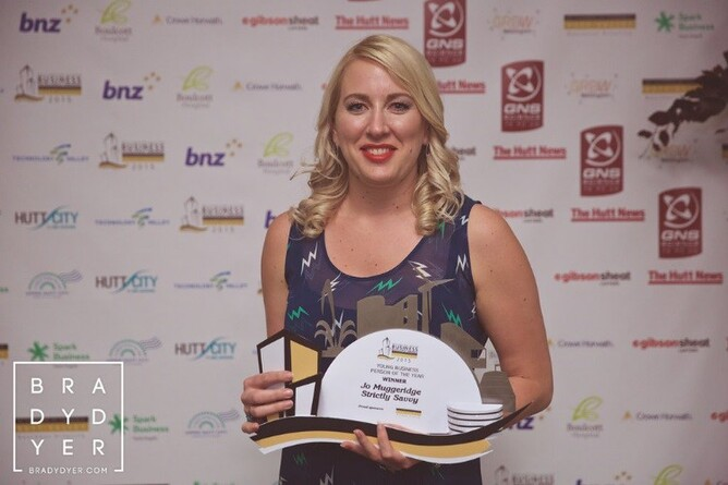 Jo with her Young Businessperson of the Year award - Photo credit: Brady Dyer Photography